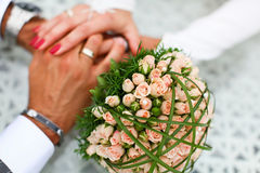 Bride and groom hand in hand together Stock Images