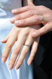 Bride and groom hands. With wedding rings stock photography