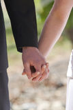 Bride and Groom hands. Bride and groom hold hands during their ceremony Stock Photos