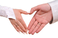 Bride and groom hands. Making heart Stock Photo