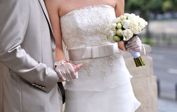 Bride and groom hands Stock Images