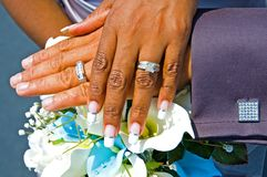 Bride and Groom hands. A close up view of the hands and rings of a newly married African-American couple Stock Photo