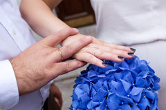 Bride and groom hands and blue wedding bouquet Stock Image