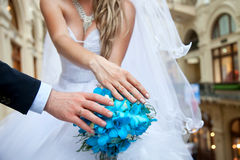 Bride and groom hands and blue wedding bouquet Stock Photo