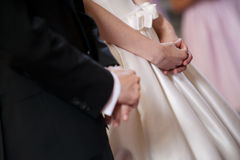 Bride and groom hands at the cerimony. Royalty Free Stock Images