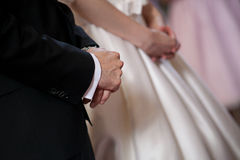 Bride and groom hands at the cerimony. Stock Photo