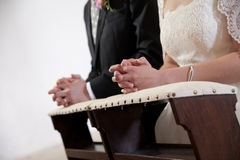 Bride and groom hands at the cerimony. Royalty Free Stock Image