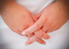 Bride and groom hands. Entwined Stock Images