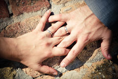 Bride and groom hands. Entwined Stock Image