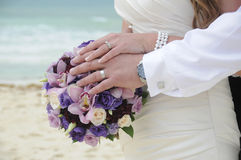 Bride and groom hands and flowers Royalty Free Stock Photos
