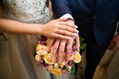 Bride and groom hands with wedding rings. Bride and groom hands with gold wedding rings Stock Photo