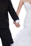 Bride and groom hands holded together. Bride and groom hands holed together over white background Royalty Free Stock Photos