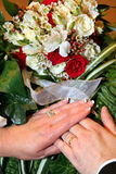 Bride and Groom Hands with Rings. And flowers after wedding Royalty Free Stock Image