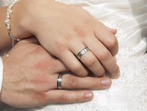 Bride and groom hands showing rings Stock Images