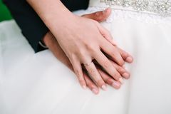 Bride and groom hands together stock photo