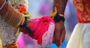 Bride and Groom Hands Together at an Indian Wedding Ceremony. Bride and Groom Hands Together at an Indian Wedding Royalty Free Stock Image