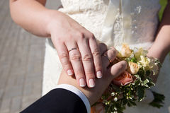 Bride and groom hands and wedding bouquet Stock Photo