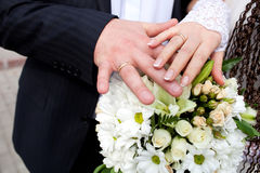 Bride and groom hands and wedding bouquet Royalty Free Stock Images