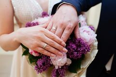 Bride and groom hands with wedding rings Stock Images