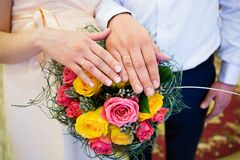 Bride and groom hands with wedding rings Stock Photo