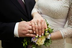 Bride and groom hands with wedding rings. Bride and groom hands with gold wedding rings Royalty Free Stock Photos