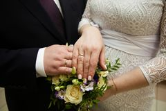Bride and groom hands with wedding rings. Bride and groom hands with gold wedding rings Stock Images
