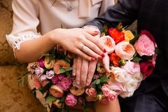 Bride and groom hands with wedding rings. Bride and groom hands with golden wedding rings Royalty Free Stock Images