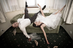 Bride and groom hangover Royalty Free Stock Photo