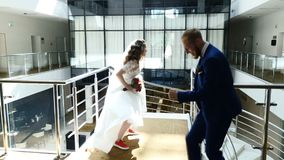 Bride and groom have fun dancing rock in hotel. Cheerful stylish newlyweds are having fun while happily dancing. Wedding stock footage