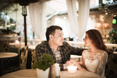 The bride and groom have romantic dinner in street cafe Stock Photography