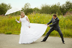 Bride and groom having fun Royalty Free Stock Images