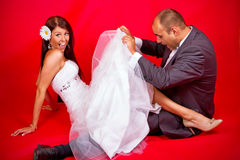 Bride and groom having fun Stock Image