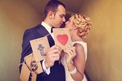 Bride and groom having fun Stock Photos