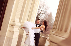 Bride and groom having fun Royalty Free Stock Photo