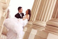 Bride and groom having fun Stock Photography