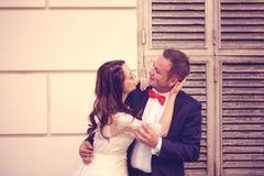 Bride and groom having fun Royalty Free Stock Photos