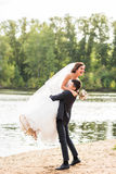 Bride and groom having fun in nature Royalty Free Stock Images
