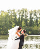 Bride and groom having fun in nature Stock Photo