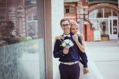 Bride and groom having fun in an oldtown Stock Photos