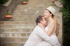 Bride and groom having fun Stock Image