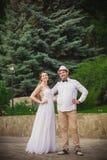 Bride and groom having fun Stock Photo