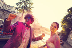 Bride and groom having fun on wedding day Stock Image