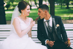 Bride and groom having an ice cream royalty free stock image