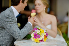 Bride and groom having an ice cream outdoors Stock Photo