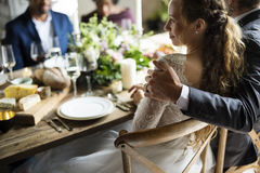 Bride and Groom Having Meal with Friends at Wedding Reception Stock Photos