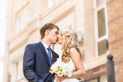 Bride and groom having a romantic moment on their Royalty Free Stock Photography