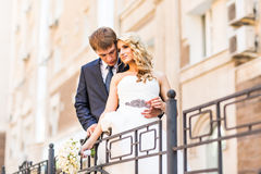 Bride and groom having a romantic moment on their Royalty Free Stock Image