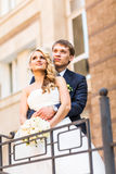 Bride and groom having a romantic moment on their Royalty Free Stock Photos