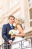 Bride and groom having a romantic moment on their Stock Image