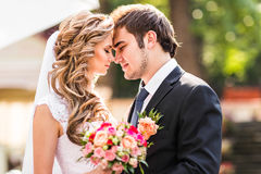 Bride and groom having a romantic moment on their wedding day Stock Images